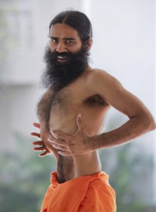 110327-indias-yoga-guru-swami-ramdev-performs-yoga-during-his-fast-against-co